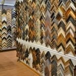 Wall display of picture frame options at Damico Gallery