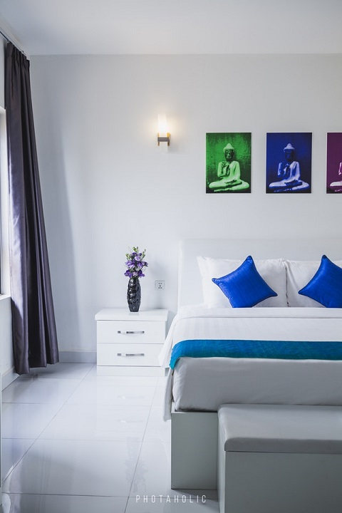 quality of life; white hotel room with bold splashes of color on the walls